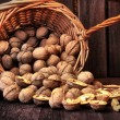 Fresh walnuts in the basket — Stock Photo #54971799