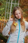 Blond girl threatening finger at the park — Stock Photo