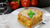 Beef Lasagna and fresh tomatoes — Stock Photo