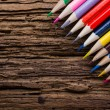 Colorful drawing pencils closeup on old grunge wooden background — Stock Photo #80492990