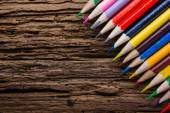 Colorful drawing pencils closeup on old grunge wooden background — Stock Photo