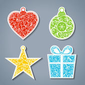 Vector set of paper Christmas stickers. — Stock Vector