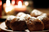 Plate of oliebollen presented in a cosy setting — Stock Photo