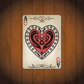 Ace of hearts poker card old look varnished wood background — Stock Vector