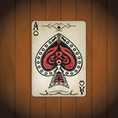 Ace of spades poker card old look varnished wood background — Stock Vector