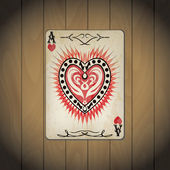 Ace of hearts poker card old look wood background — Stock Vector