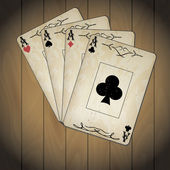 Ace of spades, ace of hearts, ace of diamonds, ace of clubs poker cards old look varnished wood background — Stock Vector