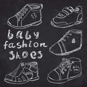 Baby fashion shoes set sketch handdrawn on blackboard — Stock Vector