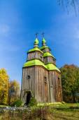 Old wooden church on a background of autumn forest — Stock Photo