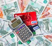 Credit card calculator lying on Russian money — Stock Photo