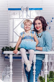Smiling little girl with her older sister standing next to a Chr — Stock Photo