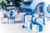White Christmas gifts with blue ribbons — Stock Photo