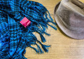 Red gift box, Scarf and hat on wooden. — Stock Photo