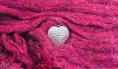 Close up Silver heart on scarves decorated for Valentine's Day.  — Stock Photo