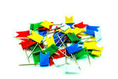 Multicolored flag pins on white background. — Stock Photo