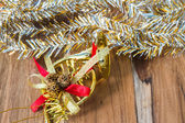 Golden Christmas and New Year decoration on the wooden floor. — 图库照片