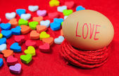 Valentines day background with love text on egg and colorful hea — Photo