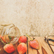 Strawberry jar, glasses on a wooden, process color with Vintage — Stock Photo #67296473