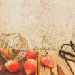 Strawberry jar, glasses on a wooden, process color with Vintage — Stock Photo #67296849