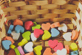 Colorful small hearts in basket, Process color with vintage tone — Stock Photo