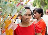 Women around Buddhism charity event — Stock Photo
