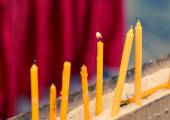 Candles in Buddhism temple closeup — Stock Photo
