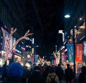 People walk around shopping street in Seoul, South Korea at nigh — Stock Photo