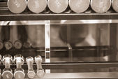 Row of dumbells sepia — Stock Photo