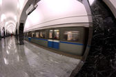 Subway station interior and train in motion — Stock Photo