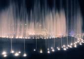 Illuminated fountain night — Stock Photo