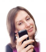 Woman communicating mobile SMS isolated white — Stockfoto