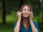 Young woman ajusting coiffure — Stok fotoğraf