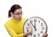 Woman pointing clock time isolated  white — Foto Stock