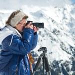 Girl photographer mountains — Stock Photo #63422825