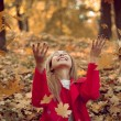 Woman drop up leaves — Stockfoto #67352517