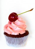 Cupcake with whipped cream and cherry — Stock Photo