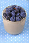 Blueberry in a bowl on blue dotted cloth — Stock Photo