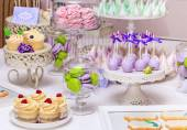 Sweet holiday buffet with cupcakes and meringues — Stock Photo