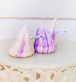 Tender white and violet meringues — Stock Photo