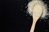 Golden rice on wooden spoon — Foto de Stock
