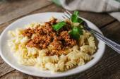 Hot pasta with sauce on a white plate — Stockfoto