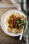 Hot pasta with sauce on a white plate — Foto Stock