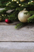 Christmas ornaments on a spruce branch — Stock Photo