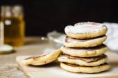 Pancake hot sprinkled with powdered sugar on white plate — Stock Photo