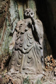 Budda made of stone inside the cave — Stockfoto