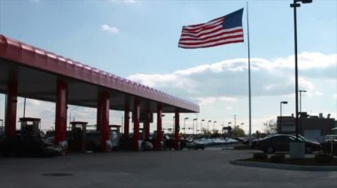 American Flag next to Gas Station — Stock Video