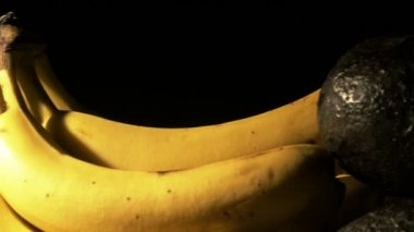 Bananas and avocados — Stockvideo