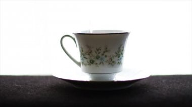 Tea cup with tea bag — Stock Video