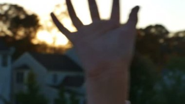 Sunshine passing through fingers — Stock Video