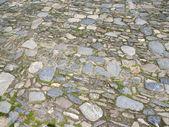 A cobblestone yard flooring background — Stock Photo